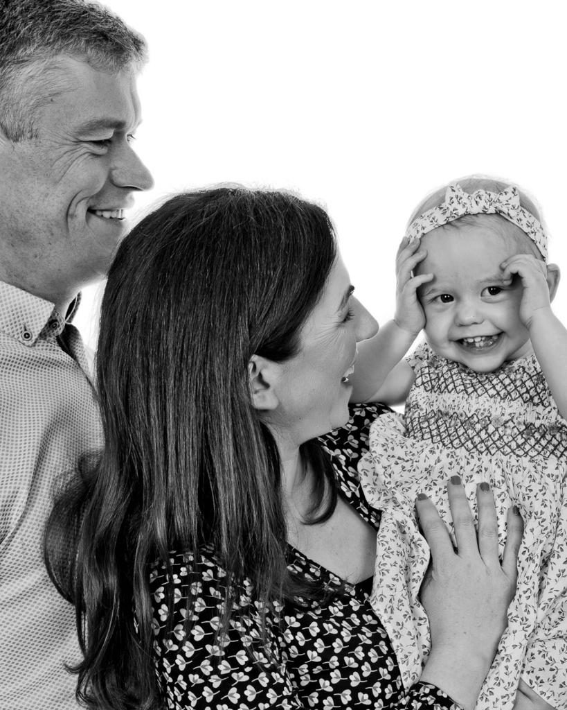 A smiling Tessa with her Mam Orla and her Dad Mark