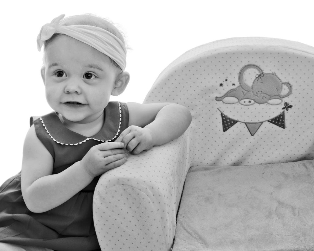 Tessa with her favourite chair which she loves to climb into.